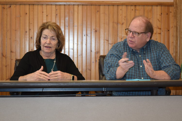 State Sen. Betty Little, left, and town of Harrietstown Supervisor Mike Kilroy talk at a meeting Friday on the potential uses of the former armory building and property on state Route 3 in Saranac Lake. (Enterprise photo -- Chris Knight)
