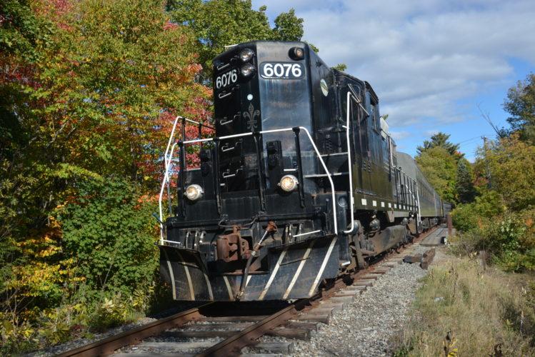 The Adirondack Scenic Railroad makes its way through Saranac Lake in October 2015.  (Enterprise photo — Lou Reuter)
