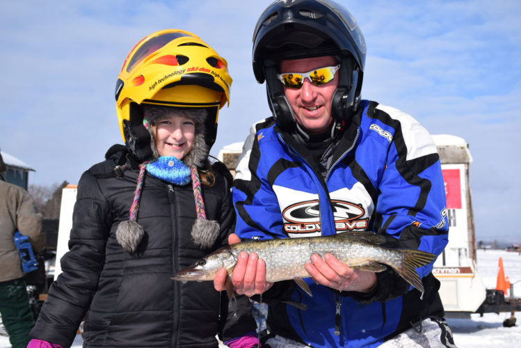 Maddison Buffett, left, and Derek Barse show off the 2.85-pound northern pike they caught during the annual Northern Challenge Ice Fishing Derby on Lake Simon in the village of Tupper Lake. Check Tuesday's Enterprise for full coverage and results, which weren't available this morning. (Enterprise photo — Justin A. Levine)