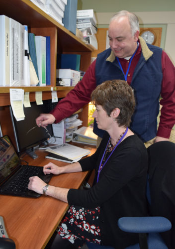 Nick George, the new executive director of High Peaks Hospice, stands next to hospice Outreach Coordinator Tania McCabe at the organization's administrative office in Saranac Lake. (Enterprise photo — Chris Knight)