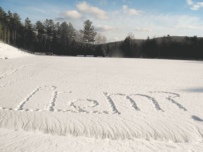 A proposal for prom was written in the snow on Ampersand Ave. in Saranac Lake Wednesday. (Enterprise photo — Kelly Carroll)