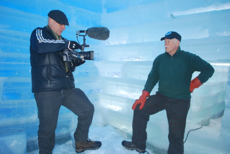 Documentary filmmaker Mark Burns, left, interviews Saranac Lake Winter Carnival Ice Palace builder Dean Baker inside the palace in February of last year. (Enterprise photo — Chris Knight)