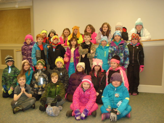 PETROVA ELEMENTARY SCHOOL THIRD GRADE STUDENTS — On Jan. 27, the Petrova Elementary School third-grade classes toured the library's Dickert Wildlife Museum. Half of the students are shown in the Community Room of the Saranac Lake Free Library. Their teachers are Mr. Bill Wilson, Mrs. Ali McCormick, Mrs. Sara Shatraw and Mrs. Wendy O'Brien. Teacher assistants are Mrs. Darlene Peer and Mrs. Laurie Woodruff. (Photo provided)
