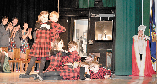 The Winter Carnival Pages perform during last week's Coronation ceremony at the Harrietstown Town Hall in Saranac Lake. The pages are Maddie Stavenhagen, Sophia McBride, Essie Ames, Lukas Miemis, Paul Fogarty and Ebin Meissner. (Enterprise photo — Antonio Olivero)