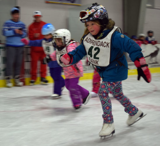 A group of kindergartners leave the starting line Friday during the Saranac Lake Winter Carnival kids skating races at the Saranac Lake  Civic Center. (Enterprise photo —  Chris Knight)