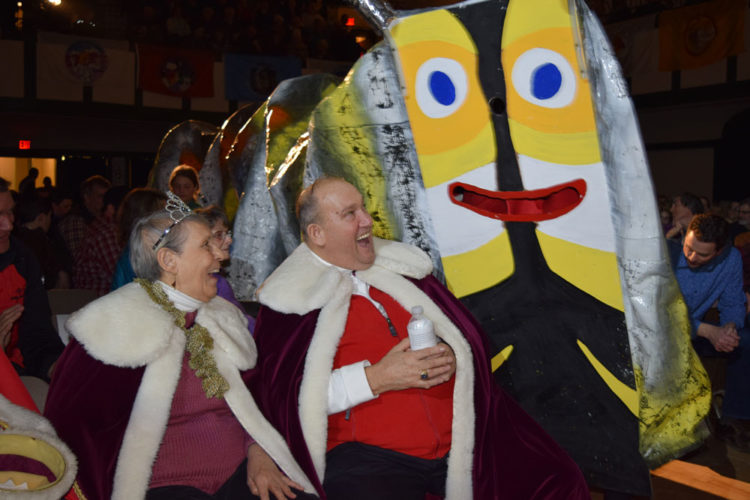 The Rotary Dancers, dressed as a caterpillar, enter the Harrietstown Town Hall auditorium Friday night, surprising Saranac Lake Winter Carnival King John Wamsganz and Queen Anita Meserole, during the final performance of the annual Rotary Club Variety Show. (Enterprise photo — Chris Knight)