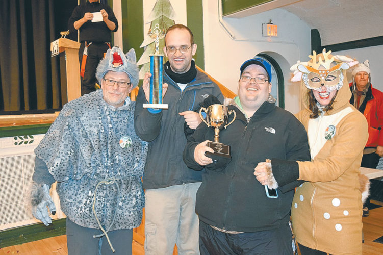 Members of the Kiwanis Club of Saranac Lake hold the Louis Fobare Memorial Trophy for the best float in the parade, awarded to them at the Harrietstown Town Hall. From left are Keith Freeman, Ricky Sullivan, Jason Borden and Aggie Pelletieri. (Enterprise photo — Chris Knight)