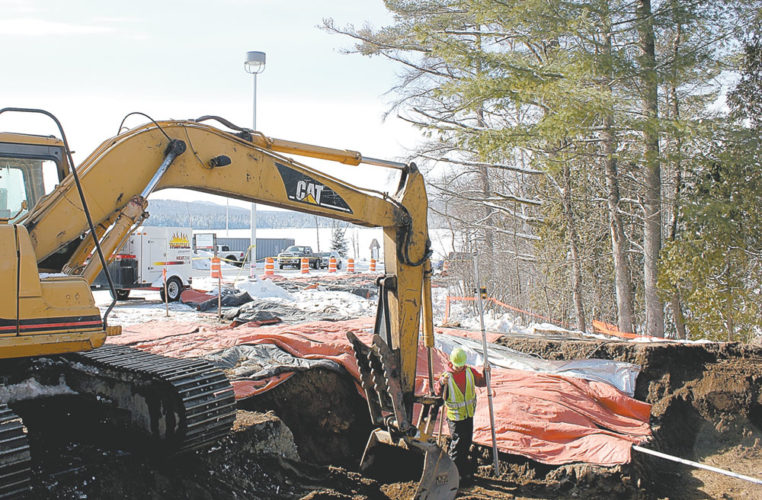 An excavator works behind Adirondack Medical Center in Saranac Lake Tuesday as part of the construction of the hospital's new surgical services wing. Another major project for Adirondack Health, a proposed Health and Medical Fitness Center in Lake Placid, remains on hold until the spring. (Photo provided —Adirondack Health)
