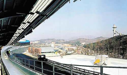 With the track at the Alpensia Sliding Center in the foreground, the vista unfolds below at the mountain cluster in Pyeongchang, South Korea, where events will be held at the 2018 Olympic Winter Games. (Photo — Jayson Terdiman)
