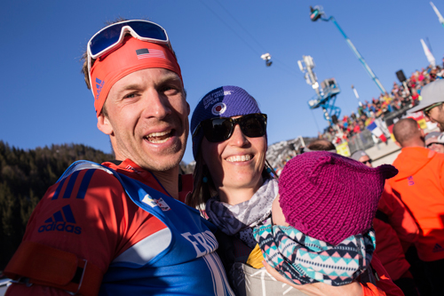 Lowell Bailey shares his gold-medal moment with his wife Erika and daughter Ophelia on Thursday at the biathlon world championships in Hochfilzen, Austria. (Photo — NordicFocus/US Biathlon)