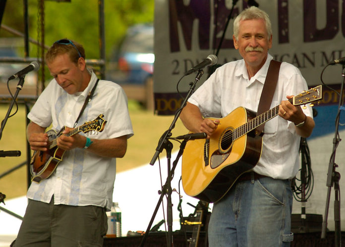 Lowell, left, and George Bailey, both musicians, perform in the George Bailey Trio at the Mountain Music Meltdown festival on June 30, 2007, in Saranac Lake. (Enterprise photo — Lou Reuter)
