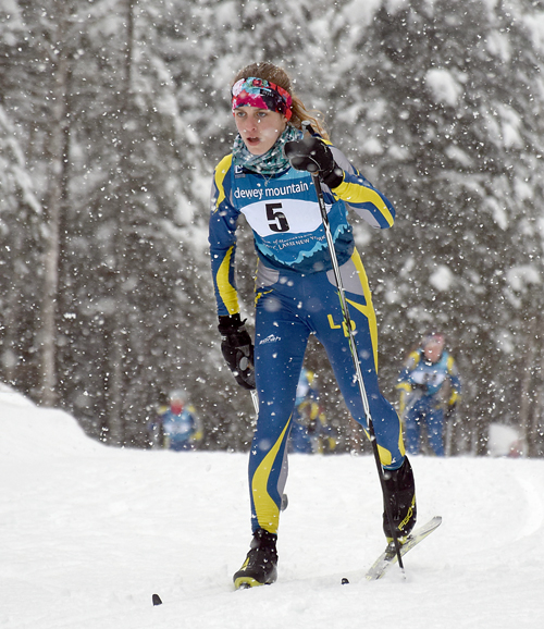 Lake Placid's Marli Damp makes her way through the falling snow during Thursday's Section VII championship race at Mount Van Hoevenberg. Damp finished second overall for the girls, and will be part of the team at the NYSPHSAA championships in South Bristol in less than two weeks. (Enterprise photo — Justin A. Levine)