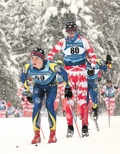 Lake Placid senior Henry McGrew, left, builds an early lead on Saranac Lake's Lauchlan Cheney-Seymour during Thursday's 8-kilometer classic ski race at Mount Van Hoevenberg. Both boys earned spots in the NYSPHSAA meet. (Enterprise photo — Justin A. Levine)