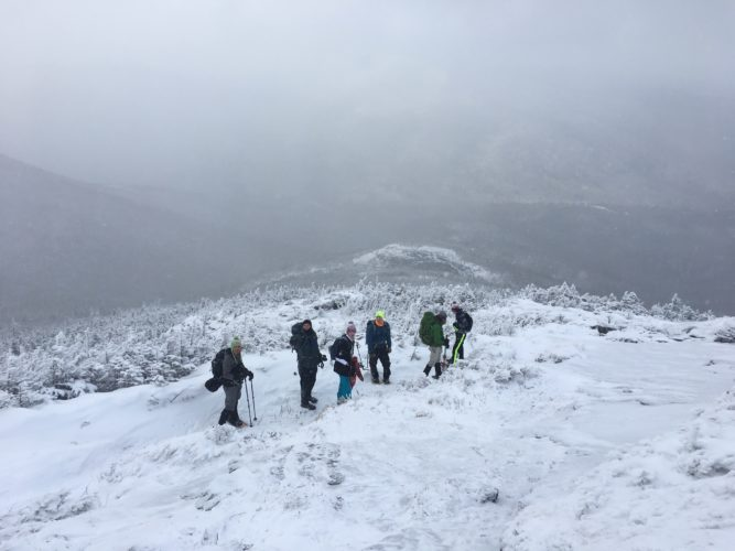Adirondack Wilderness Trip Leader Tyler Socash leads a group of hikers down the icy exposed summit of Wright Peak in the High Peaks on Jan. 7. (Enterprise photo — Antonio Olivero)