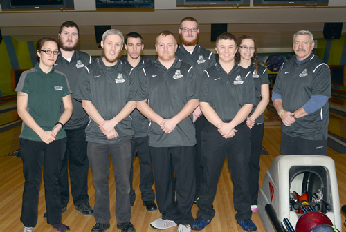 Members of the Paul Smith's College bowling team gathers for a photo prior to their home match against Adirondack Community College on Thursday at Romano's Saranac Lanes. It was the first time in three seasons the Bobcats hosted an opponent. Front row from the left: Dana Tompkins, head coach Phil Muha, Chris Beckwith and Jon Herrman. Back row from the left: Kyle Martin, Frank Keegan, Ben McInerney, Kalei Fenn and coach Rod Bushey. (Enterprise photo — Lou Reuter)