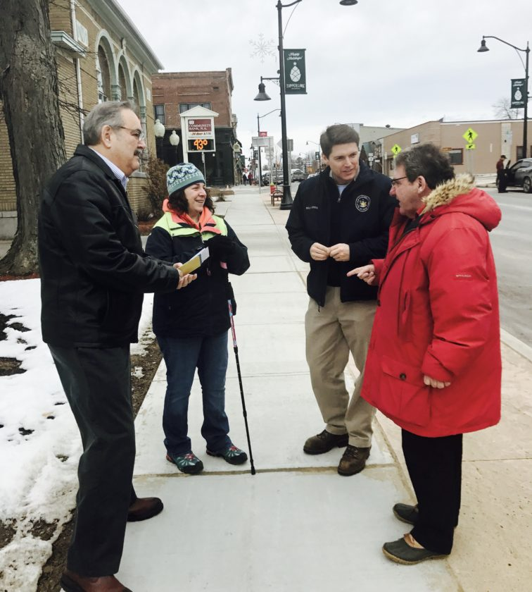 State Assemblyman Billy Jones, second from right, talks with Tupper Lake officials and residents during a tour of the village on Tuesday. Standing with him on Park Street are, from left, Dean Lefebvre, Donna Sabin and village Mayor and Franklin County Legislator Paul Maroun. (Photo provided)