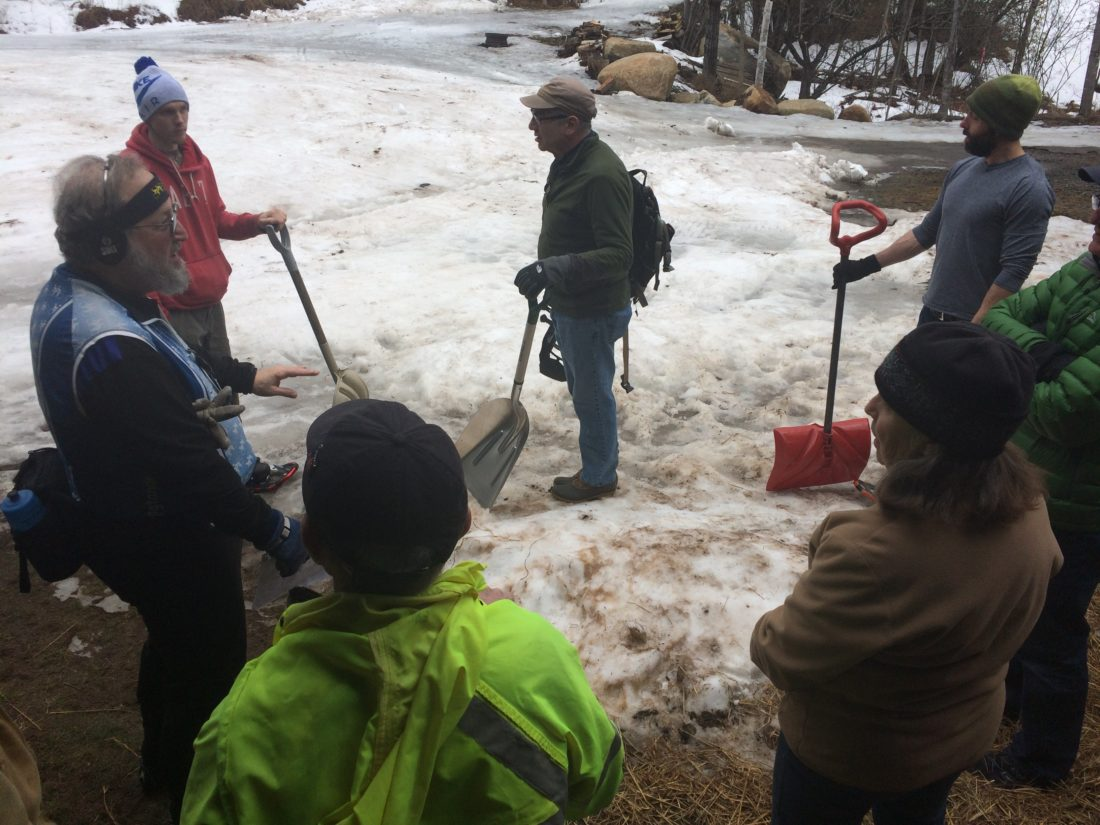 Volunteers gather at Dewey Mountain Recreation Center Friday morning to help organizers prepare for Saturday's World Snowshoe Championships, which were moved entirely to the mountain. (Enterprise photo — Chris Knight)