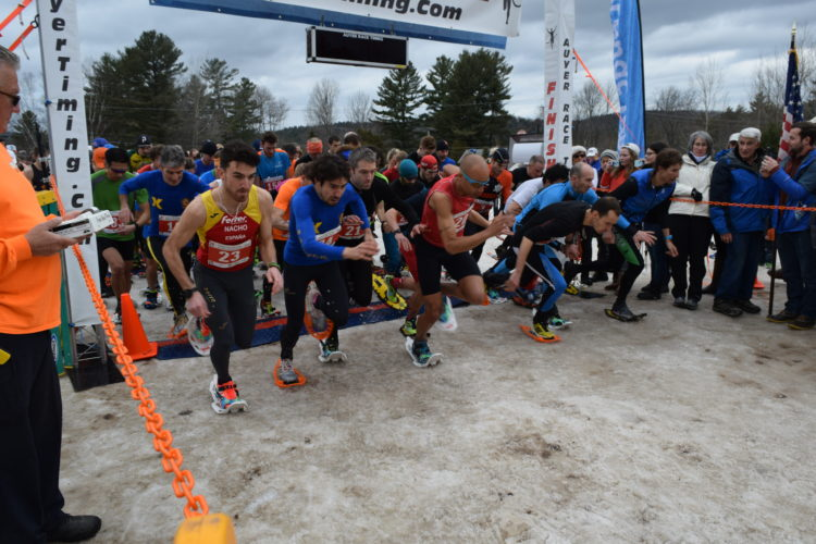 Racers leave the starting line Saturday at the World Snowshoe Championships in Saranac Lake. (Enterprise photo -- Chris Knight)