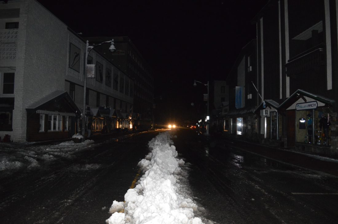 Main Street, Lake Placid, is dark except for car headlights around 10 p.m. Saturday amid a power outage. (Enterprise photo — Antonio Olivero)