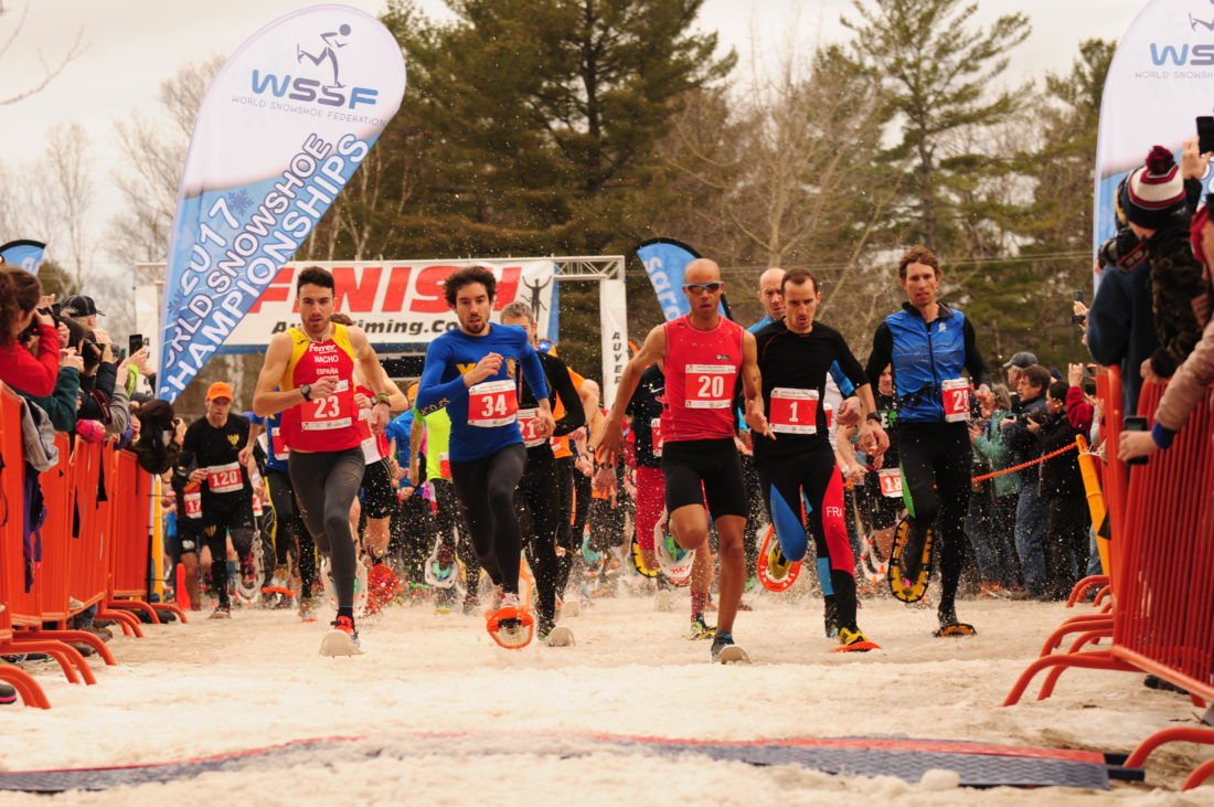 With the elite competitors at the front of the pack, a field of more than 260 athletes leave the start line at Dewey Mountain Saturday to begin their 8-kilometer run in the 2017 Snowshoe World Championships. Included in the photo from the left are Spain's Nacho Hernando-Angulo (23) and Roberto Ruiz Revuelta (34), the eventual winner Joseph Gray (20), last year's defending champion Stephan Ricard (1) of France and Josiah Middaugh of Colorado (28). (Enterprise photo — Lou Reuter)