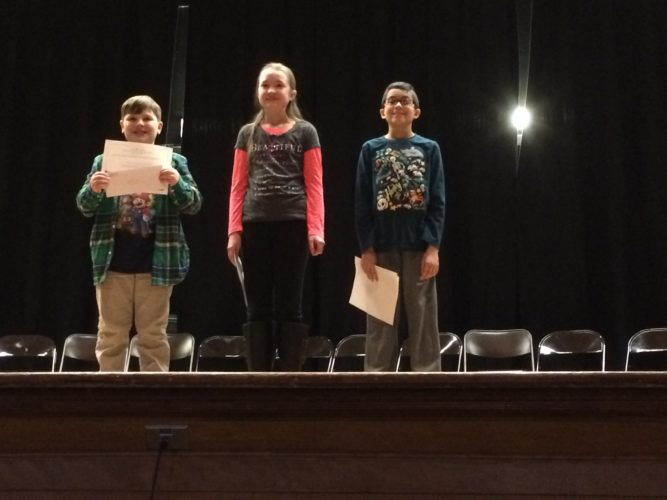 The Petrova Elementary School Spelling Bee winners, from left, are Carter Nicastro, second runner-up; Sabine Denkenberger, champion;  and Liam Fletcher, first runner-up. (Photo provided)