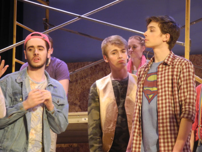 """""""Godspell"""" cast members, from left, Matthew Varden, Noah Cordes, Delanie Clark, and Dorran Boucher bring one of many Biblical parables to life during Monday night's dress rehearsal at Tupper Lake High School. There will be an encore with music from """"Godspell"""" Thursday at Big Tupper Brewery. (Enterprise photo — Ben Gocker)"""