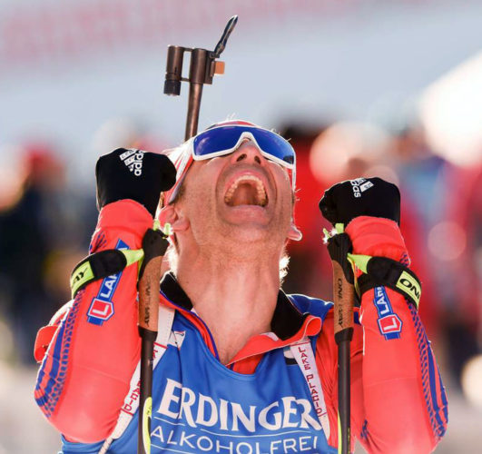 Lowell Bailey of Lake Placid celebrates after winning first place in the World Championship individual biathlon event Feb. 16 in Hochfilzen, Austria. (Photo provided — U.S. Biathlon/Nordic Focus)