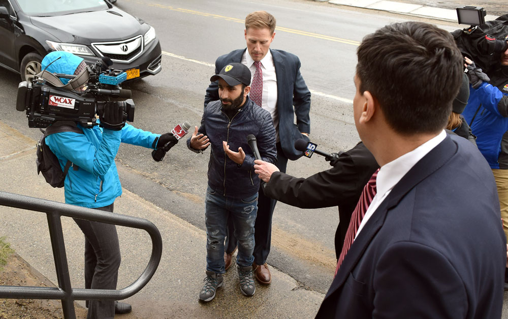 Tanveer Hussain speaks to television news reporters Tuesday afternoon outside the St. Armand Town Hall in Bloomingdale, where he declined a plea bargain. (Enterprise photo — Chris Knight)