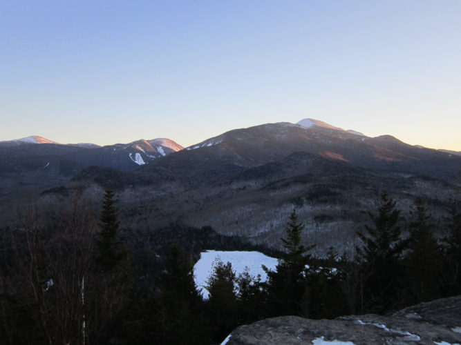 Enjoying the twilight view of Heart Lake and the  High Peaks from the summit of Mount Jo (Photo provided — Diane Chase)