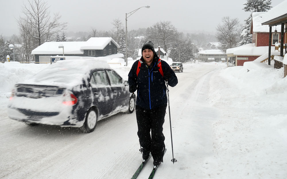 Alex Hudson cross-country skis up Sentinel Road this morning on his way to work at The Cottage. (Enterprise photo — Antonio Olivero)