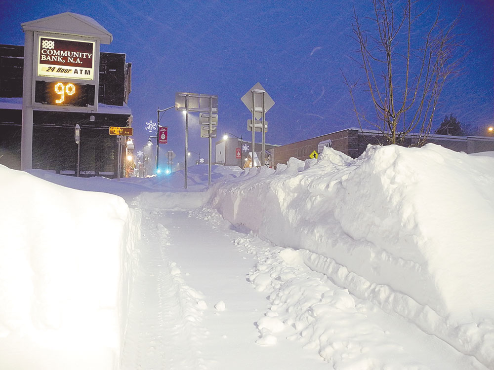 Park Street and Cliff Avenue, Tupper Lake, are fairly empty around 6:30 this morning after getting more than 2 feet of snow the day before. (Enterprise photo — Ben Gocker)