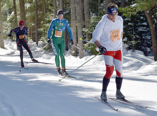 From right, Matthew Cook, Tyler Magnan and Jan Wellford race in the 50-kilometer freestyle race Saturday during the Loppet at Mount Van Hoevenberg. Cook, of Saranac Lake, finished 14th in 3:16:13.4, Magnan, of St. Albans, Vermont was fourth in 2:51:18.6 and Wellford, of Keene placed sixth in 2:56:31.6. (Enterprise photo — Justin A. Levine)