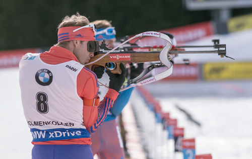 Lowell Bailey takes aim during the World Cup biathlon mass start Sunday in Oslo, Norway. (Photo — US Biathlon/Nordic Focus)