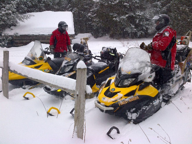Forest rangers used snowmobiles to help rescue a man who became stranded in the deep snow after climbing Seymour and Seward mountains on March 15. (Photo provided)