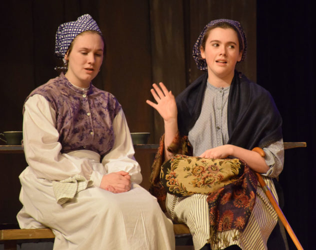 "Natalie Orman, left, and Sarah Dalton perform during a dress rehearsal Tuesday of Saranac Lake High School's ""Fiddler on the Roof,"" which will take the stage Thursday, Friday and Saturday. (Enterprise photo — Justin A. Levine)"