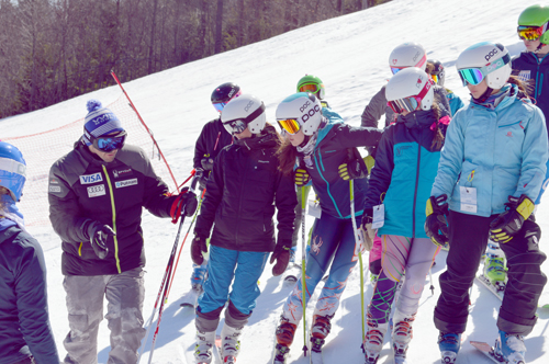 U.S. Ski team member Tommy Biesemeyer, of Keene, gives pointers to a group of under-14 New York Ski Educational Foundation skiers. Biesemeyer, who has been on the U.S. team for eight years, was part of the NYSEF program as a youngster. (Photo provided)
