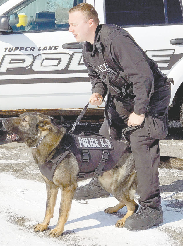 Tupper Lake Police Department K9 officer JD wears his new protective vest alongside handler officer Jordan Nason.  (Photo provided by Tupper Lake Police Department)