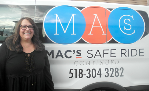 Vivian Smith poses next to the MAC's Safe Ride Continued van. (Enterprise photo — Ben Gocker)