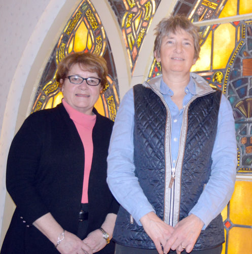 Donna Beal, Executive Director of Mercy Care for the Adirondacks, and Office Coordinator Jenn Grisi, right, help to run the friendship volunteer program with Sister Catherine Cummings (not pictured). (Enterprise photo — Antonio Olivero)