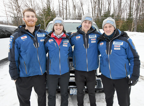 USA Luge national team members, from the left, Jonny Gustafson, Summer Britcher, Tucker West and Taylor Morris stand in front of their van at Mount Van Hovenberg after getting in some spring sliding on a rainy Friday afternoon. Members of the team are taking advantage of the refrigerated track over the next couple weeks to get in final runs and test equipment with the  next Winter Olympics less than a year away. (Enterprise photo — Lou Reuter)
