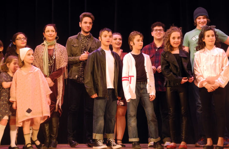 Performers on stage at Tupper Lake Middle-High School's auditorium await the judge's results for Tupper Lake's Got Talent. From left are members of the Rhythm Jax, Matthew Varden (taller, left-center), members of the Kool Kids (front row) and in back, left from Varden, Kendall Davison, Mitch Jensen and Ben Jones. (Enterprise photo — Ben Gocker)