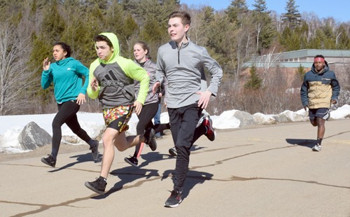 Members of the Saranac Lake track and field team run sprints Thursday at the high school. Pictured, from left, are Jada Meadows, Tyler Callahan, Randi Rondeau, Owen Wilson and Abraham Newton. The boys and girls teams open their season April 25 at home against Plattsburgh. (Enterprise photo — Justin A. Levine)
