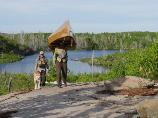 "Dave and Amy Freeman walk along Minnesota's Boundary Waters for the film, ""Bear Witness."" (Photo provided by Dave Freeman)"