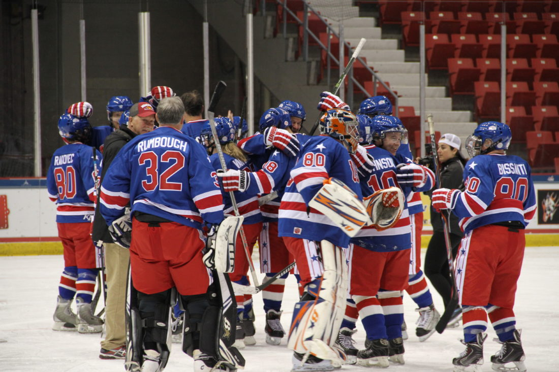 Members of Mike Ramsey's Red Light District celebrate after winning the gold medal Wednesday afternoon during the Miracle on Ice Fantasy Camp at the Olympic Center in Lake Placid. In all, 14 of the 19 members of the 1980 U.S. Olympic hockey team and 55 campers participated in the event, which began on Sunday and wrapped today. (Enterprise photo — Andy Flynn)