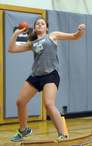 Tupper Lake shot putter Ava Cuttaia practices Monday afternoon in the L.P. Quinn Elementary school gymnasium. The Lumberjacks girls track and field team opens the season April 26 on the road in Canton. Their first home meet is May 3 against Ogdensburg and Potsdam. (Enterprise photo — Justin A. Levine)