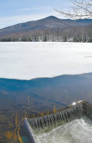 Debar Mountain is seen Monday afternoon from the dam and outlet of Debar Pond in Duane. The dam is just steps away from an Adirondack Great Camp that was built in the late 1930s. (Enterprise photo — Justin A. Levine)
