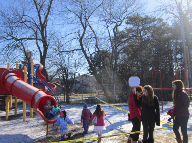 Volunteers help direct young Easter Egg seekers during the Bloomingdale Easter Egg Hunt. (Photo provided — Diane Chase)