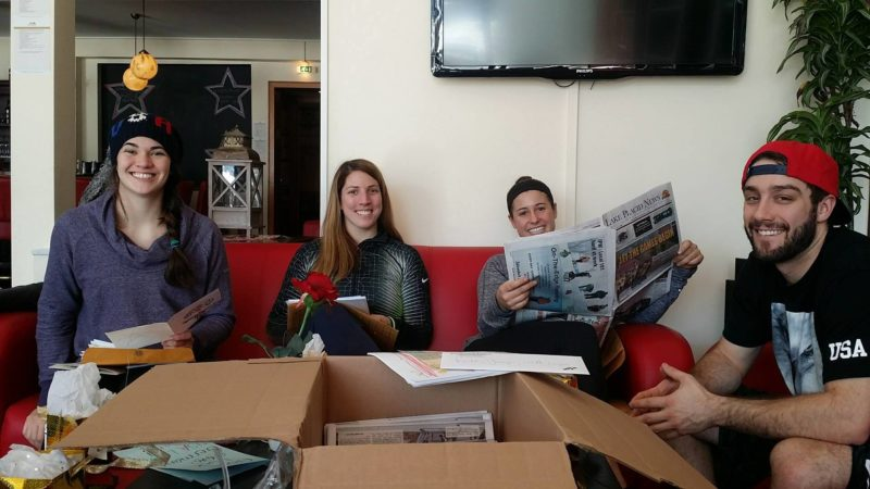 USA Luge athletes on the World Cup tour go through a care package from Lake Placid they received at the Hotel Winterberg Resort in Winterberg, Germany, in February 2016. The package - organized and sent by the Lake Placid News - included almost 300 cards and letters of support from students at three Lake Placid schools. From left are Summer Britcher, Erin Hamlin, Emily Sweeney and Jayson Terdiman. (Photo courtesy of USA Luge)