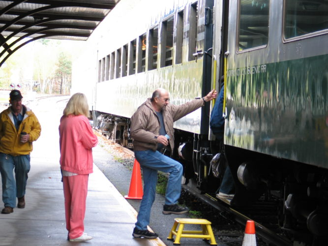 People board the Adirondack Scenic Railroad train at the Union Depot in Saranac Lake.  (Enterprise file photo — Chris Knight)