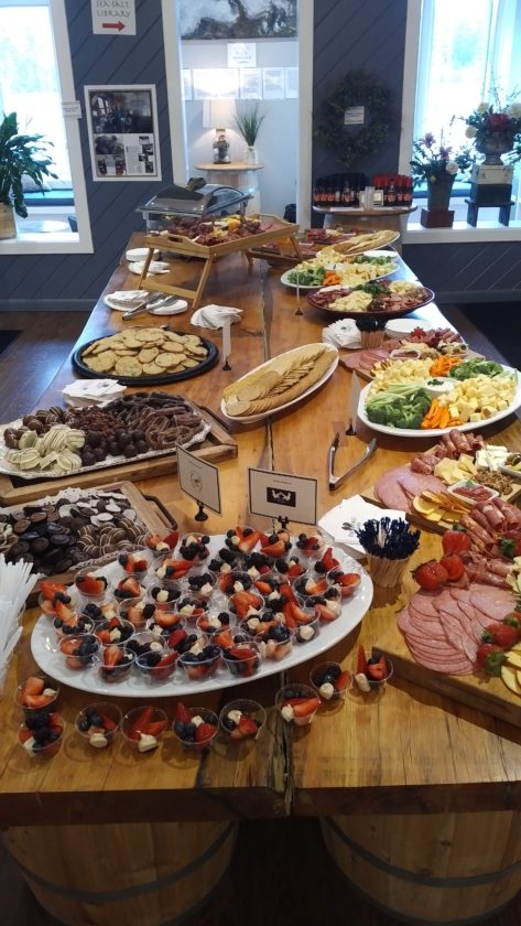 An opening reception for the inaugural EAT ADK Restaurant Week is held in May 2016 at the Saratoga Olive Oil Company. (Photo provided by EAT ADK)